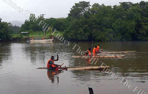 Youths of Nadogo get ready for the Bilibili race at Wainikoro river. Picture: LUISA QIOLEVU