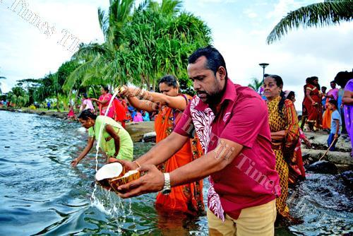 Sonny Ram (closet to camera) of Shiv Mandir Ramayan Bhanjan Mandali and devotess perfroming the last rituals of Ram Naumi at the Suva Foreshore yesterday. Picture: JONA KONATACI