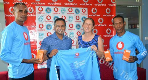 Petero Manoa (left) Rajnesh Prasad, Vodafone chief marketing officer Marita Manley and Eroni Takape during the presentation at the Vodafone head office in Tamavua yesterday. Picture: ATU RASEA