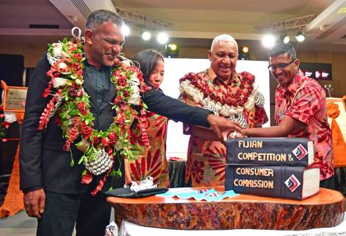 The cutting of the cake to celebrate the rebranding and launch of the Fijian Competition & Consumer Commission's (FCCC) new strategic plan. Picture: SUPPLIED