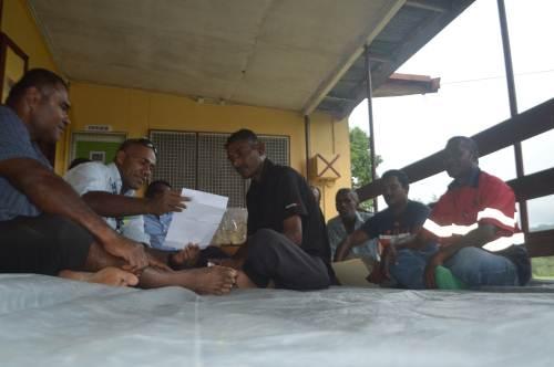 Divisional Lands officer North Josefa Vuniamatana discusses an issue with their tenants at Nagigi outside Labasa. Picture: SERAFINA SILAITOGA