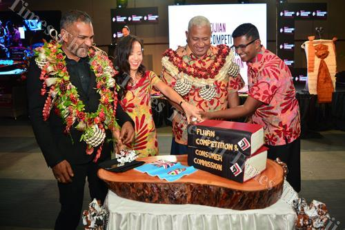 Minister for Industry, Trade and Tourism Faiyaz Koya, Fijian Competition and Consumer Commission chairperson Joann Young, Prime Minister Voreqe Bainimarama, and FCCC chief executive officer Joel Abraham cut a celebration cake during the launch of the new