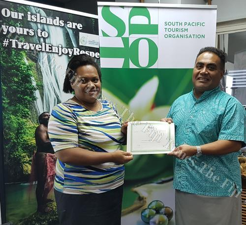 """South Pacific Tourism Organisation (SPTO) administration officer Fane Dinono, left, receives her award for being the overall winner of the """"Be the Change"""" challenge from SPTO chief executive officer Chris Cocker. Picture: SUPPLIED"""