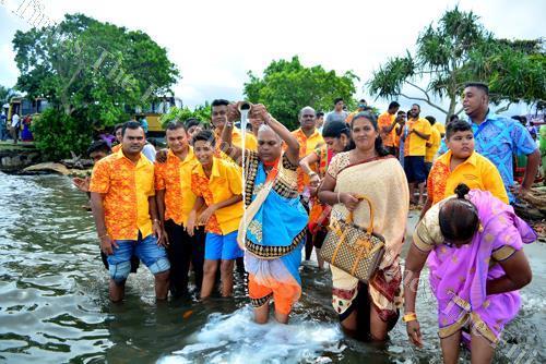 Members of the Shree Guru Sharnagath Ramayan Mandali perform the last rituals of Ram Navami at the Suva foreshore. Picture: JONA KONATACI