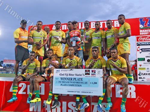 The Wardens team with their prize during the 42nd Fiji Bitter Marist 7s tournament at the ANZ Stadium in Suva on Saturday. Picture: JONACANI LALAKOBAU