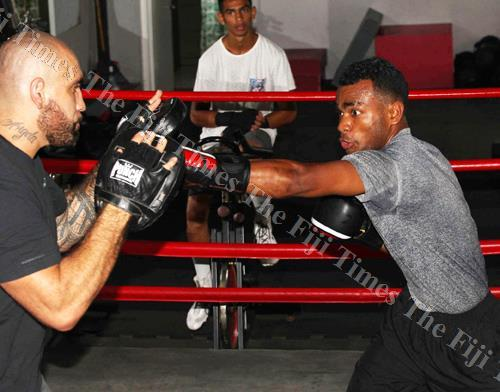 Boxer Jone Koroilagilagi Davule during a training session with his coach Napoleon Taumoepeau in Suva. Picture: JONA KONATACI