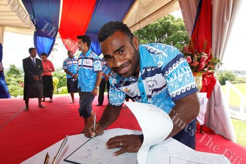 Fiji 7s captain Jerry Tuwai signs the visitors book at Borron House during the Team Fiji itatau last week. Picture: ELIKI NUKUTABU