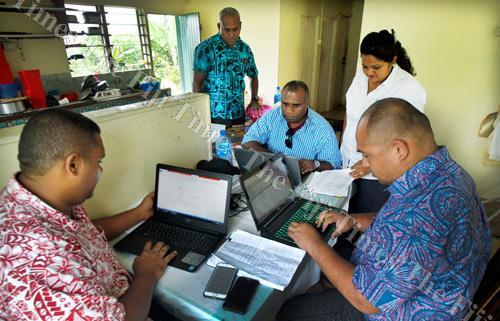 Members of the Ministery of Health central outbreak respond team working at the Navesau SDA school in Wainibuka yesterday.Picture ATU RASEA