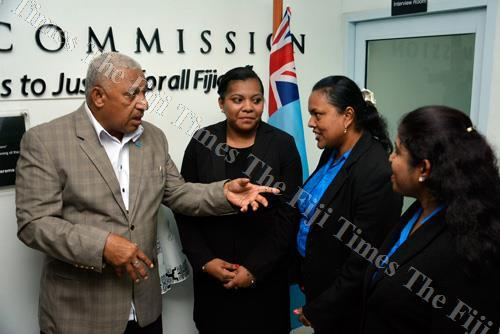 Prime Minister Voreqe Bainimarama speaks to Grace Henao, second from left, Sarita Kumar and Pretika Kumar during the Legal Aid Commission's office opening in Tavua. Picture: BALJEET SINGH