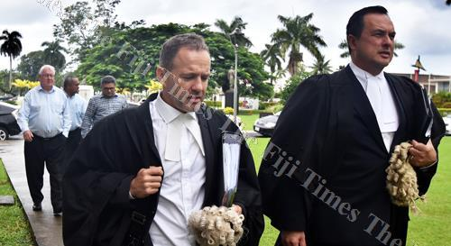 Lawyers Nick Barnes (left) and Wylie Clarke lead The Fiji Times publisher Hank Arts, The Fiji Times editor-in-chief Fred Wesley and Motibhai Group resident director Rajesh Patel outside the High Court in Suva yesterday. Picture: RAMA