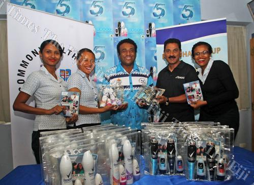 Sitiveni Tawakevou (middle) of FASANOC, receives the Rexona products given by the Motibhai Group of Companies to Team Fiji for the Commonwealth Games, in Suva yesterday. Picture: ELIKI NUKUTABU