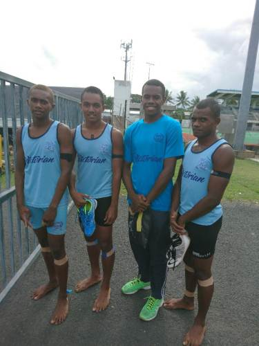 The 4x100m intermediate quartet of QVS displaying their black arm bands. Picture: TALEBULA KATE