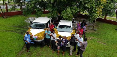 Department of Lands North staff and guests with the two new vehicles handed over to them today. Picture : LUISA QIOLEVU