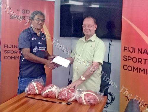 Raiwaqa basketball president Reuben Colata, left, receives the sponsorship from Fiji National Sports Commission CEO Peter Mazey. Picture: SUPPLIED