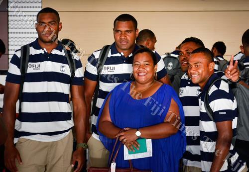 Jijilia Belle meets the Fiji Airways Fiji sevens team members at Nadi International Airport yesterday. Picture: BALJEET SINGH