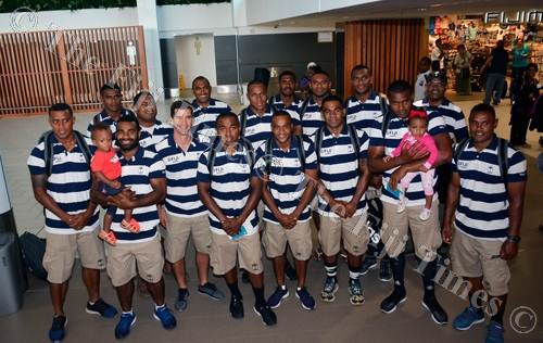 Fiji Airways Fiji sevens team members have a group picture taken after checking-in at Nadi International Airport yesterday. Picture: BALJEET SINGH