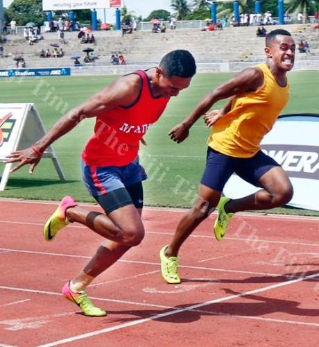 MBHS's Tony Lemeki at the finish line with and Malasebe Tuvusa of Suva Grammar School in the senior boys 100m final at the Suva Zone Two. Picture: ATU RASEA