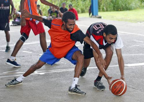Johnny Dyer, left, of Jazz battles for possession against Victor Koyamainavure of Gratham Pirates during the Raiwaqa Interlane Easter Basketball competition at Ed's Court in Raiwaqa on Saturday, March 31, 2018. Picture: JONACANI LALAKOBAU