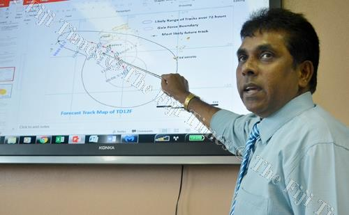 Fiji Meteorological Services director Ravind Kumar explains the projected path of the cyclone during the media briefing in Nadi yesterday. Picture: REINAL CHAND