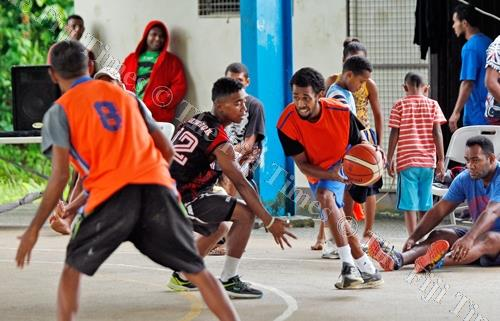 Johnny Dyer, with ball, of Jazz on attack against Gratham Pirates during the Raiwaqa Interlane Easter Basketball competition at Ed's Court in Raiwaqa on Saturday, March 31, 2018. Picture: JONACANI LALAKOBAU
