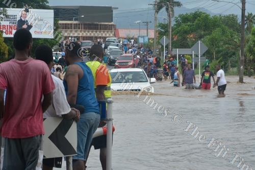 Motorists make their way across the flooded Denarau junction in Nadi. Picture: BALJEET SINGH