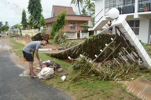 Rajiv Prasad clears the rubbish left behind by flood water in Yalalevu Ba. Strong currents brought down several compound fences in the residence. Picture: REINAL CHAND
