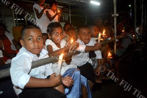Catholics celebrate Easter at the Resurrection Mass on Saturday night in Labasa. Picture: SERAFINA SILAITOGA