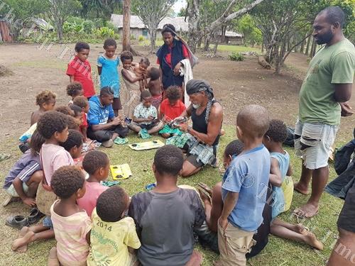 In the hills of Papua New Guinea, Tote Gallardo teaches children some art. Picture: SUPPLIED