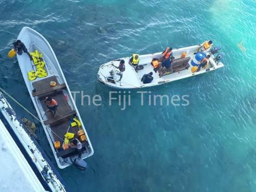 "Passengers on the ""Spirit of Altruism"" helped onto fiber glass open boats to be ferried across to the waiting Spirit of Harmony. Picture: SUPPLIED/LEPANI BATABA"