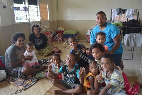Sowane Qenuku (right) with children from four families who sought shelter at the Technical College of Fiji in Nadi when flood waters swept through Nawaka Village. Picture ALVIN KUMAR