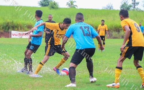 Action from Tavua (yellow jersey) and Chelsea football team from Nasinu on Saturday. Picture: SUPPLIED