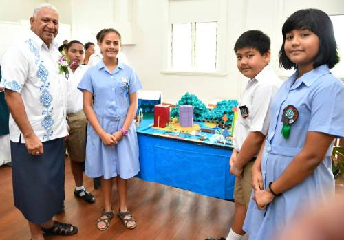 Fiji's PM Voreqe Bainimarama with students of Yat Sen Primary School in Suva at the launch at the of 'Our Home, Our People climate change Virtual Reality (VR) project in Fiji' this morning. Picture: SUPPLIED