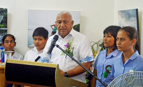 COP23 president and Fijian PM Voreqe Bainimarama with students of Yat Sen Primary School and St Annes Primary School at the launch of 'Our Home, Our people - Fiji's Climate Change Story in Virtual Reality' in Suva today. Picture: JONA KONATACI