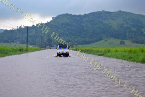 The flooded Soasoa Rd in Labasa yesterday. Picture: SERAFINA SILAITOGA