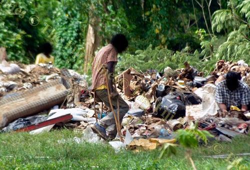 Scavengers in search of items in Ba. picture: BALJEET SINGH