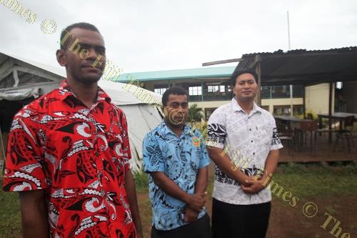The Rev Josefa Taukave, standing on the right, with two other men at Koro High School. Picture: JONACANI KONATACI
