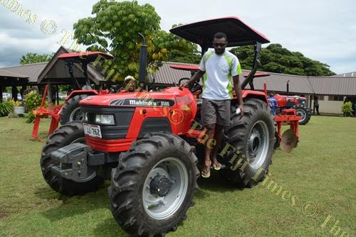 Farmer Samuela Sugu admires the new tractor. Picture: REINAL CHAND