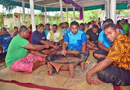 Members of the Matakibau reunite around a tanoa of grog. Picture: JOVESA NAISUA