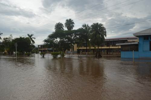 Flood waters enter the compound of All Saints Secondary School in Labasa this morning. Picture SERAFINA SILAITOGA