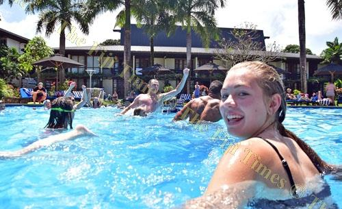 Madison Sloane, closest to camera, of Sydney, Australia enjoys a dip in the pool with other tourists at the Warwick Fiji Resort & Spa in Sigatoka in September last year. Statistics show that the occupancy rates for the past five years has been in the rang