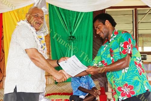 Naibuka Verebodi receives his certificate from Ministry of Rural and Maritime Development, National Disaster Management and Meteorological Services permanent Secretary Meleti Bainimarama at the closure of the training program in Vatukarasa, Nadroga. Pi