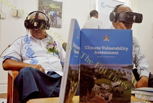 President of COP23 and Prime Minister Voreqe Bainimarama and permanent secretary for Ministry of Lands and Mineral Resources Malakai Finau watch the virtual reality film Our Home, Our People during its launch at the Suva City Carnegie Library on Tuesday.