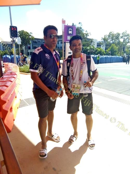 Romit Parshottam, left, and Sailesh Pala wait for a train at the Commonwealth Games Village in Brisbane, Australia. Picture: MAIKELI SERU