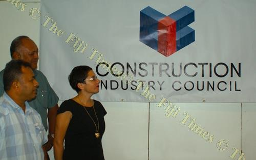 (L-R) Acting director OHS Lui Mario, Fiji Insurance Association's Sarah Jane Wild and Ron Rova quantity surveyor of the association discuss the CIC logo at the association's meeting. Picture: SUPPLIED