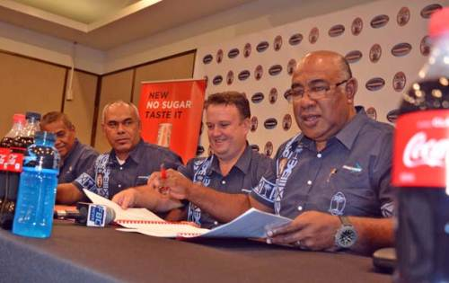 Coca-Cola Amatil Fiji general manager Roger Hare, third from left, and Fij Secondary School Rugby Union president Setareki Merekula (with glasses) during a press conference at the Holiday Inn in Suva today. Picture: JONACANI LALAKOBAU