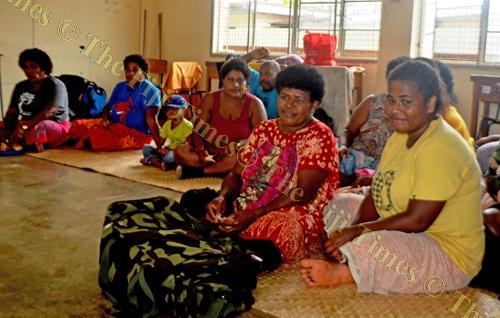 Vulovi women in Labasa keep warm at the Guru Nanak Khalsa College evacuation centre. Picture: LUKE RAWALAI