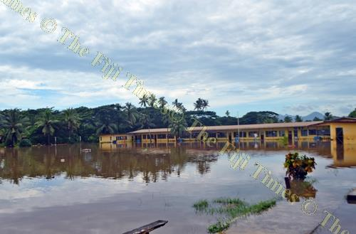 The flooded Khalsa Primary School compound in Labasa Town on Thursday. Picture: LUKE RAWALAI