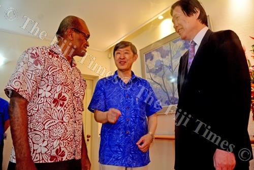 Minister for Employment Jone Usamate shares a moment with JICA president Dr Shinichi Kitaoka and Japanese ambassador to Fiji Masahiro Omura on Friday night. Picture: JONA KONATACI