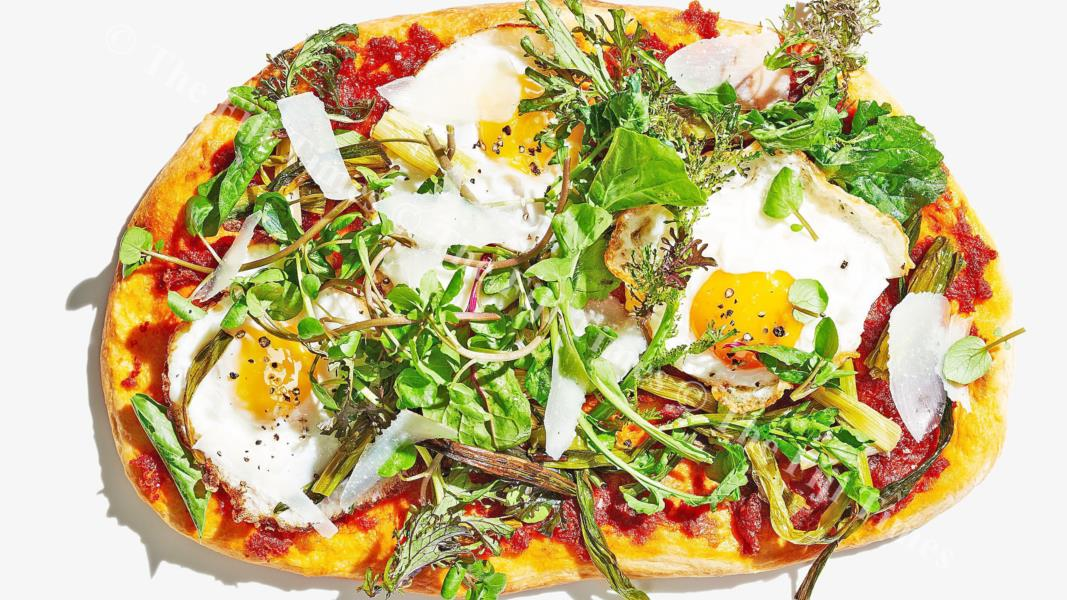 Fried eggs and greens pizza. Picture: SUPPLIED