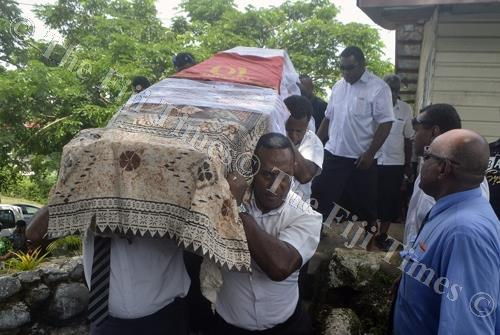 Pallbearers carry the coffin of Pita Dau after the church service in Lautoka yesterday. Picture: BALJEET SINGH